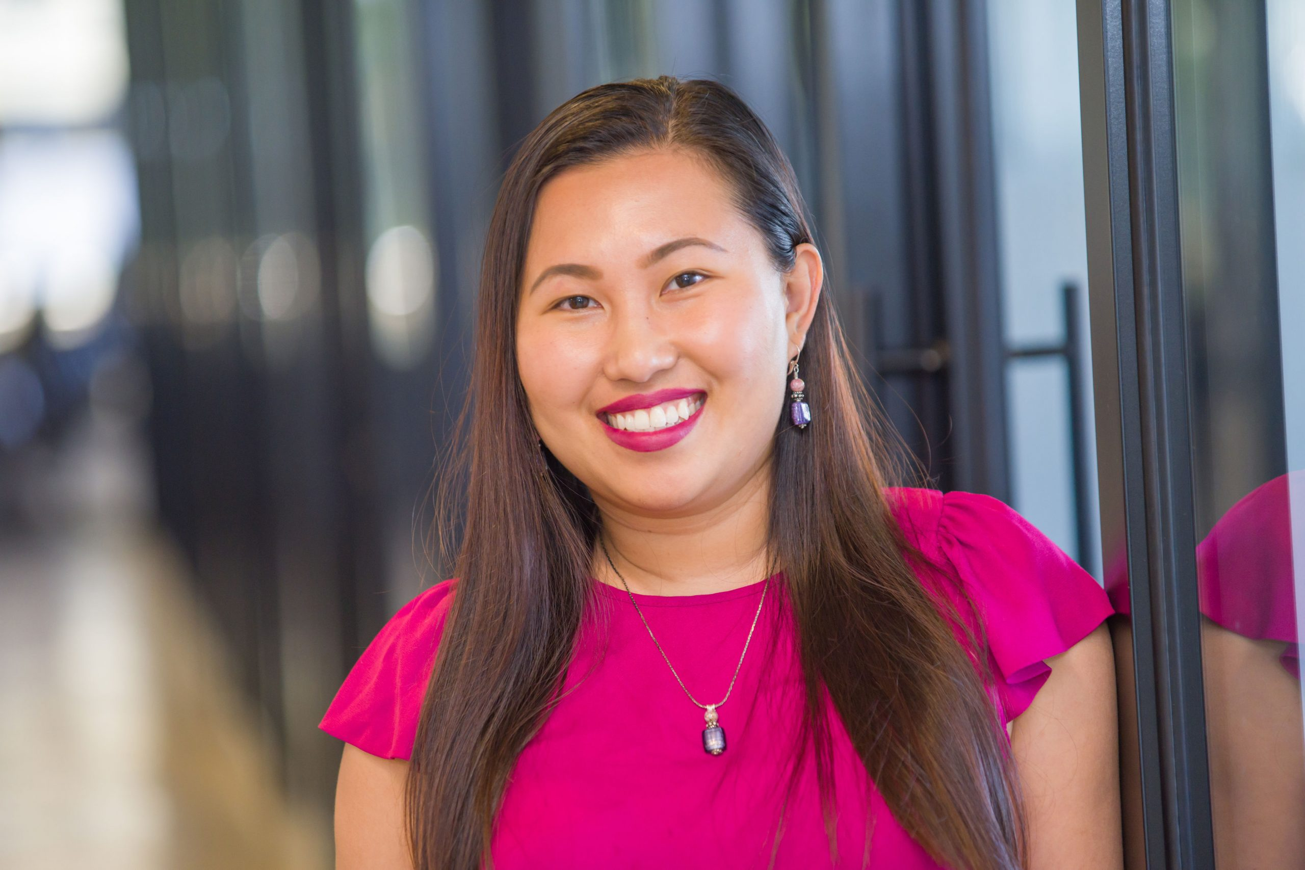 CAPTC Family Pact program manager Nicole Nguyen smiling in an office hallway